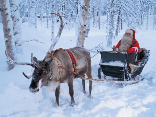 Santa Claus riding on sleigh, Lapland, Finland